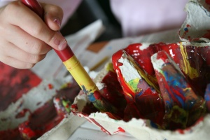 A brush full of paint can evoke horror for a stressed out mom.
