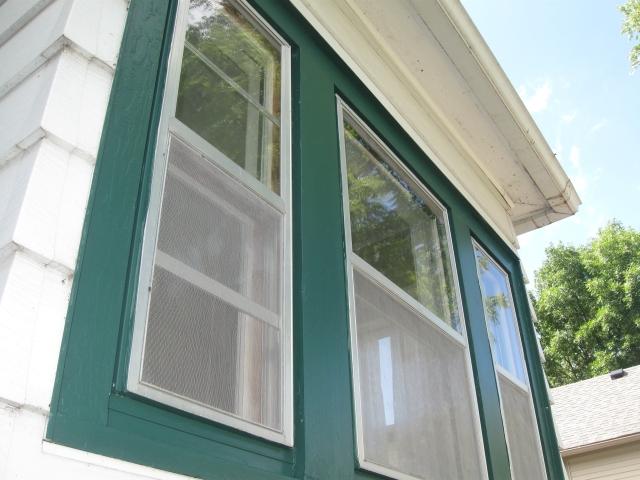 Painters came to scrape, caulk, and paint the trim around our twenty-nine windows.